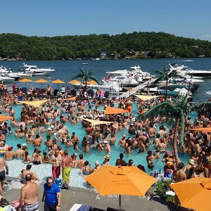 Adults partying at Coconuts Caribbean Beach Bar & Grill, one of the most popular water front pool bars at Lake of the Ozarks.