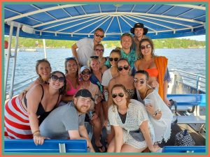 A group of adults enjoying a ride on Playin Hooky fun cruise, one of the many things to do at Lake of the Ozarks this weekend.