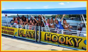 A group of young women aboard a Playin Hooky boat, enjoying a Lake of the Ozarks cruise.