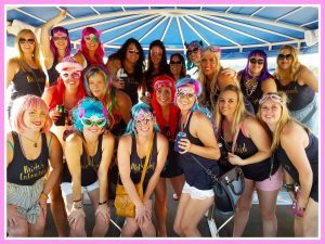 A group of young women celebrating a bachelorette party on Playin Hooky day time cruise, just one of the bachelorette party ideas Lake of the Ozarks offers.